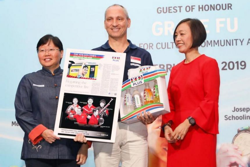 Singapore Swimming Association head coach Stephan Widmer receiving The Straits Times' Athlete of the Year nomination award on behalf of Joseph Schooling from ST sports editor Lee Yulin (left) and Ms Jennifer See, managing director, Singapore & YFI Ma