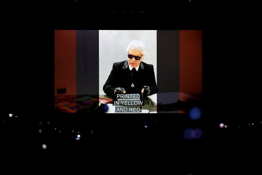 Late fashion designer Karl Lagerfeld is seen on a screen at the end of the show.