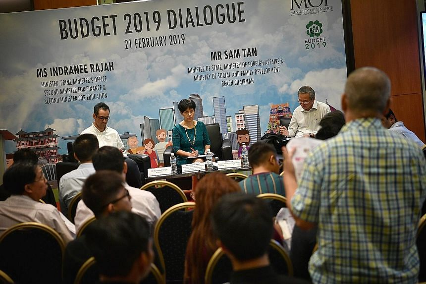 Second Minister for Finance and Education Indranee Rajah (centre) and Minister of State for Foreign Affairs, and Social and Family Development Sam Tan (right), who is also Reach chairman, fielding questions from attendees at a feedback session on the