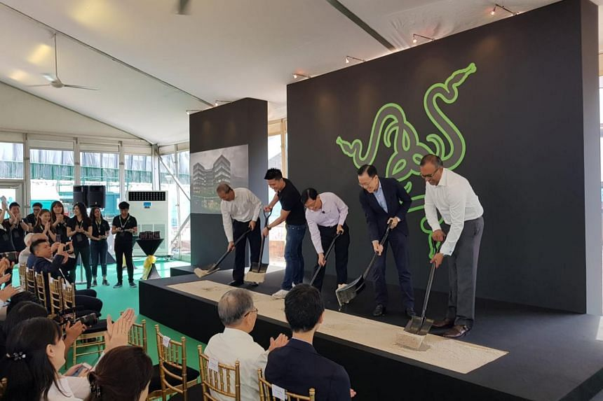 Finance Minister Heng Swee Keat (centre) flanked by Razer CEO Tan Min-Liang (left) and EDB chairman Beh Swan Gin at the ground-breaking ceremony for Razer's South-east Asia headquarters at one-north on Feb 22, 2019.