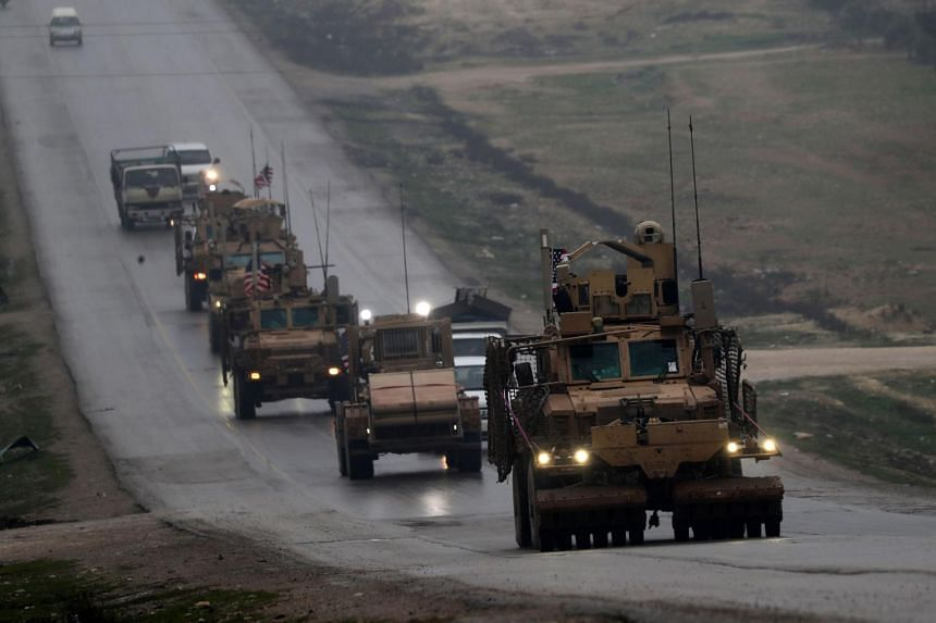 A convoy of US military vehicles rides in Syria's northern city of Manbij on Dec 30, 2018.