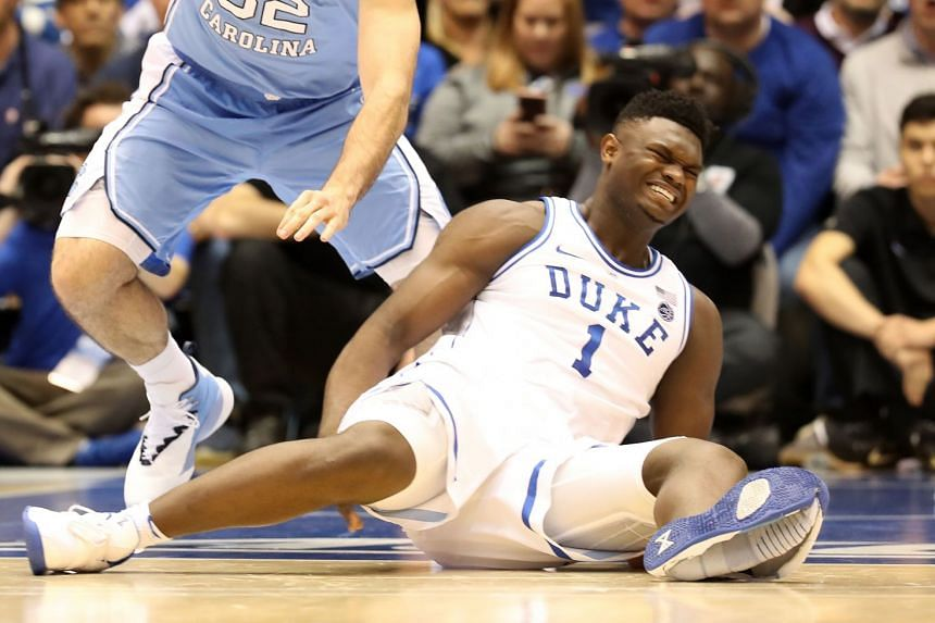 Zion Williamson reacts after falling as his shoe breaks.