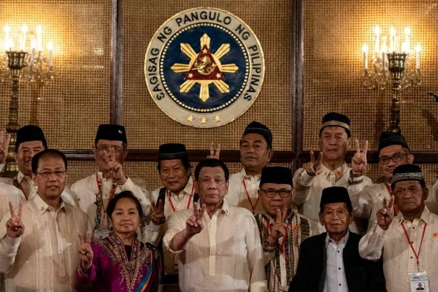 Philippine President Rodrigo Duterte with Moro Islamic Liberation Front chairman Murad Ebrahim (front row, third from right) during the Ceremonial Confirmation of the Bangsamoro Organic Law Plebescite Law Canvass Results and Oath-taking of Transition