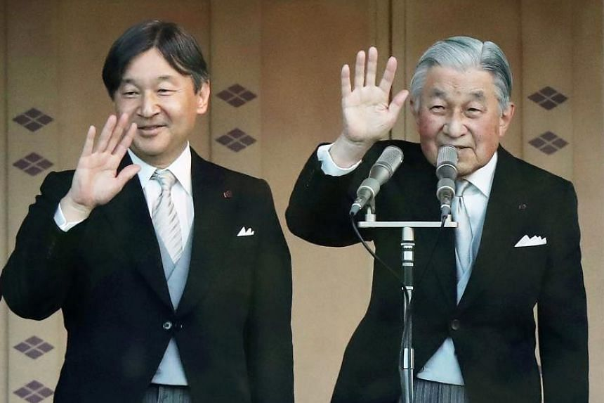Japan's Emperor Akihito and Crown Prince Naruhito at the New Year's greeting ceremony at the Imperial Palace in Tokyo on Jan 2, 2019.