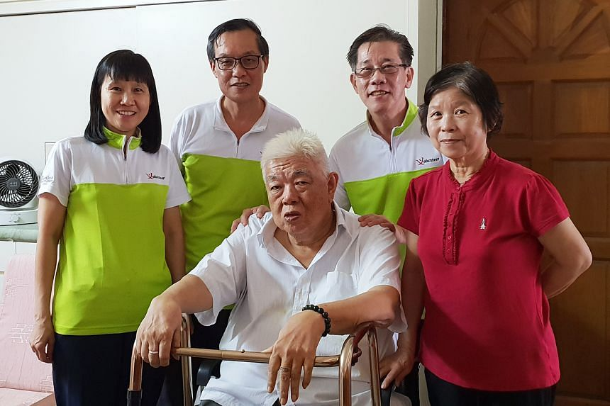 Community befrienders (from left) Mrs Chan, Mr Chan and PCS befriender coordinator Chia Hang Sing with their befriendees, Mr and Mrs Tan. PHOTO: JAC WOO