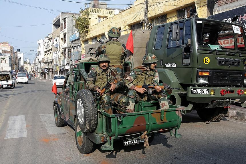 Indian soldiers on patrol during a curfew in the city of Jammu last Saturday. Opposition leaders have criticised the BJP government, accusing it of failing to prevent the attack in Pulwama and politicising it for its own benefit.