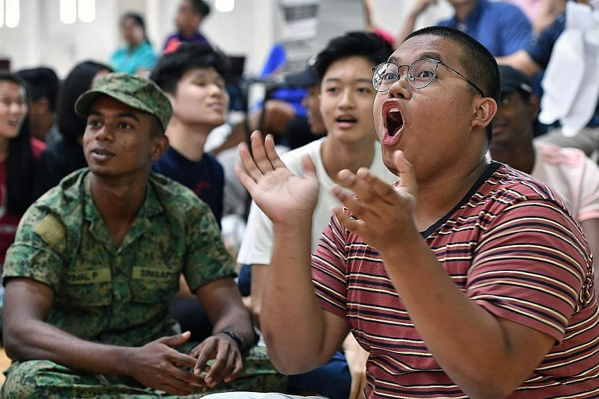 Muhammad Nur Izeyar Yazid (right) and Vimal P (in army uniform) were among four students singled out yesterday for their exemplary character by Ms Britta Seet, vice-principal of Jurong Pioneer JC.