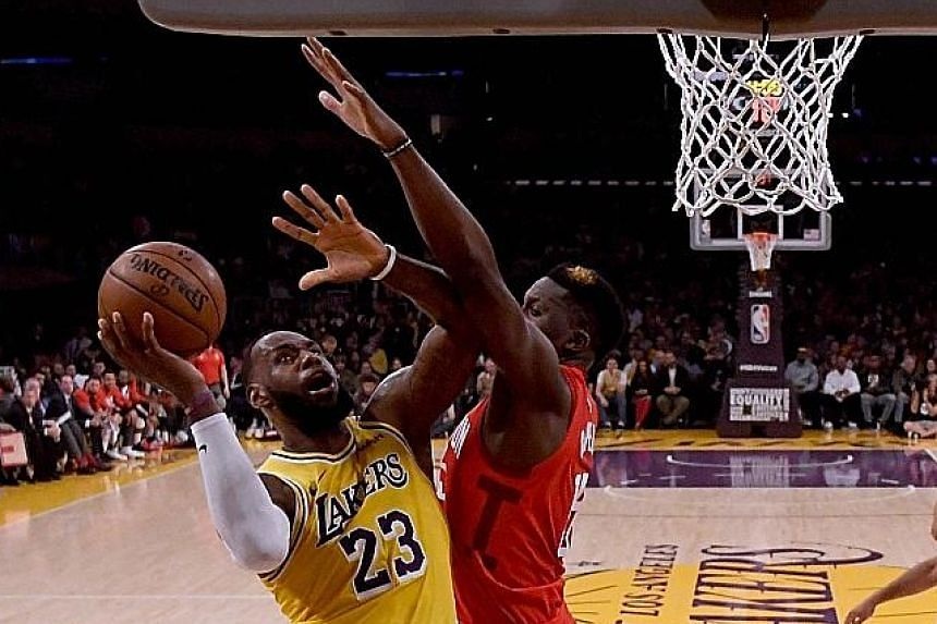 LeBron James driving to the basket under the challenge of the Houston Rockets' Clint Capela during the 111-106 Lakers win at Staples Centre on Thursday. He finished with 29 points, 11 rebounds and six assists.