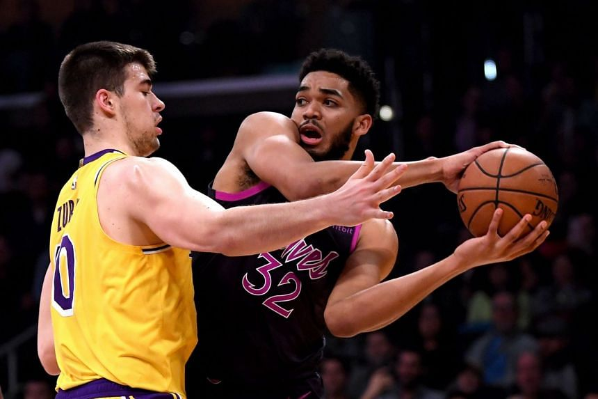 Towns looks to pass in front of Ivica Zubac, of the Los Angeles Lakers.