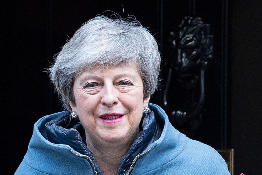 May leaves 10 Downing street in London on Feb 20, 2019, ahead of Prime Minister's Questions in Parliament.