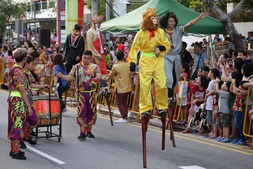 Stilt walkers dressed up as characters from Journey to the West performing during the Ang Mo Kio - Hougang Chinese New Year Street Parade.