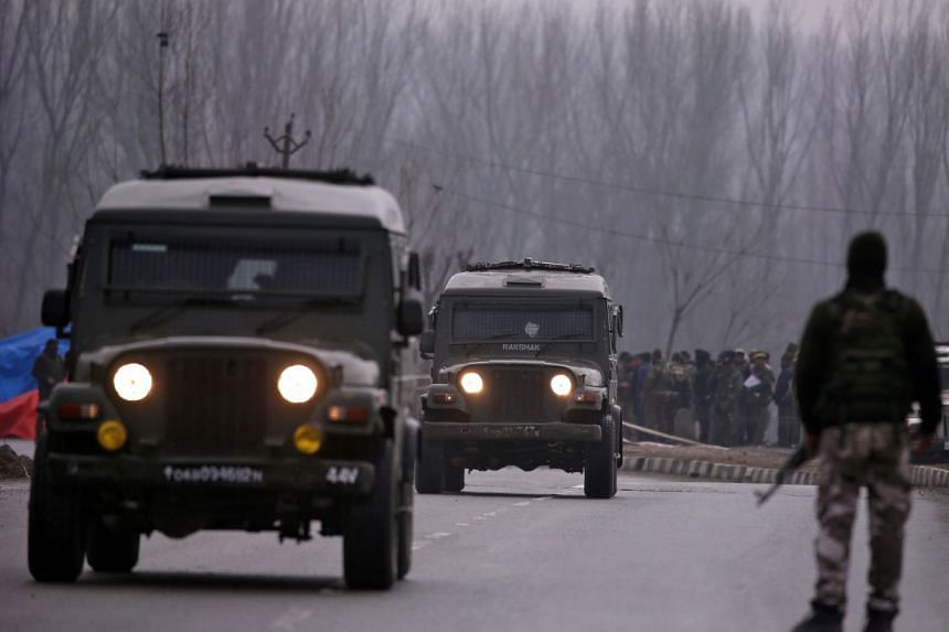 Indian soldiers stand guard near the site of a suicide bomb attack in Lethpora, Pulwama in south Kashmir on Feb 15, 2019.