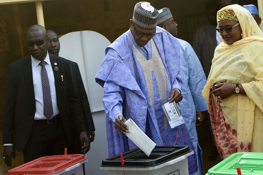 Nigerian President Muhammadu Buhari casting his vote at a polling station in his native hometown in northwest Nigeria, on Feb 23, 2019.