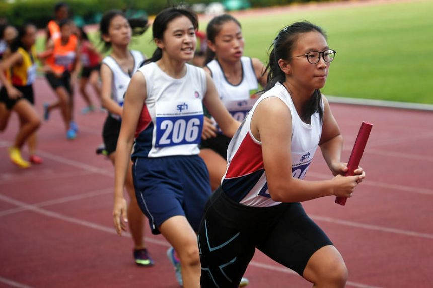 Participants in action at the SPH Schools Relay Championships at Bishan Stadium, on Feb 23, 2019.