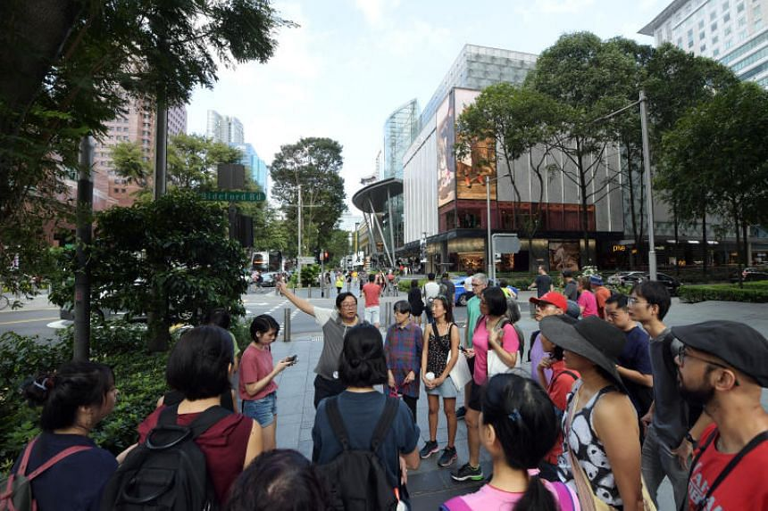 Dr Lai Chee Kien leads a tour group along Orchard Road to show how Singapore's transformation is characterised by its continuous battle with nature on Feb 23, 2019.