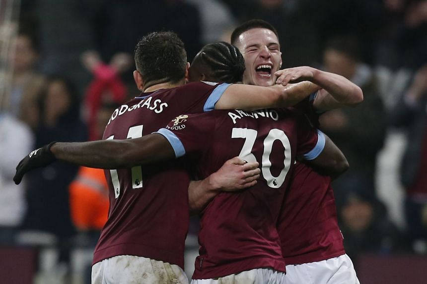 West Ham's Michail Antonio (centre) celebrates with team mates after scoring their third goal.