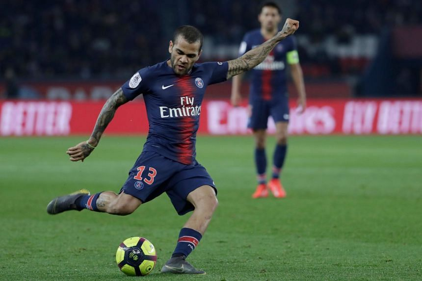 Alves passes the ball during the French L1 match.