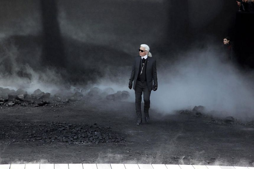 Karl Lagerfeld appears at the end of the Chanel Ready-to-Wear fall/winter presentation in Paris, on March 8, 2011.