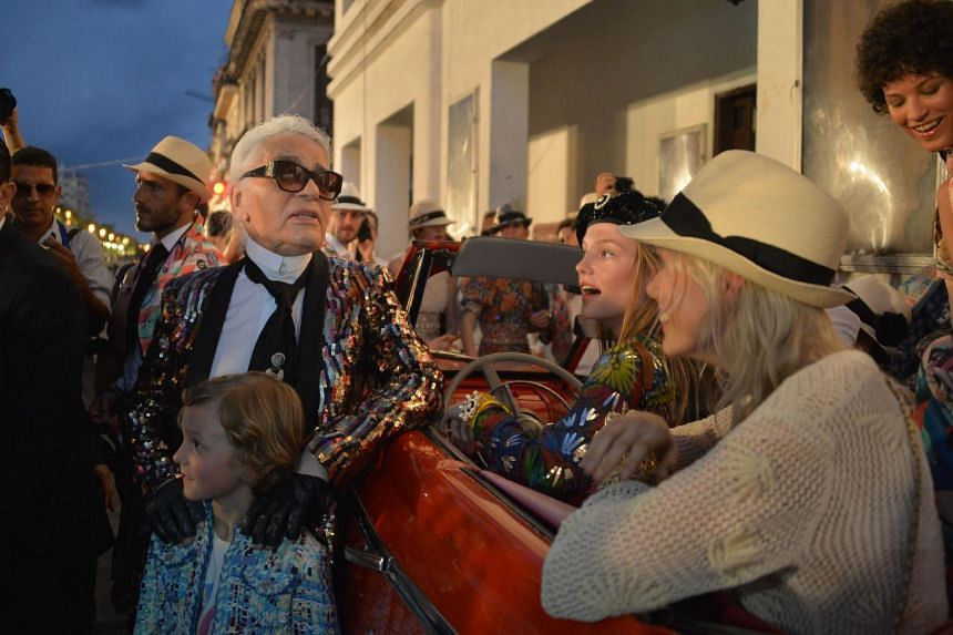 Karl Lagerfeld attends his performance for Chanel at the Prado promenade in Havana with his godson Hudson Kroenig on May 3, 2016.