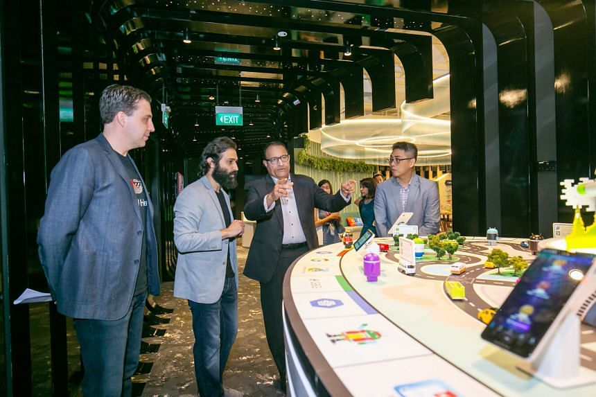 From left: Google Cloud Asia-Pacific managing director Rick Harshman and Google's programme manager for developer ecosystem, South-east Asia, Sami Kizilbash with Communications and Information Minister S. Iswaran on a tour of Developer Space @ Google
