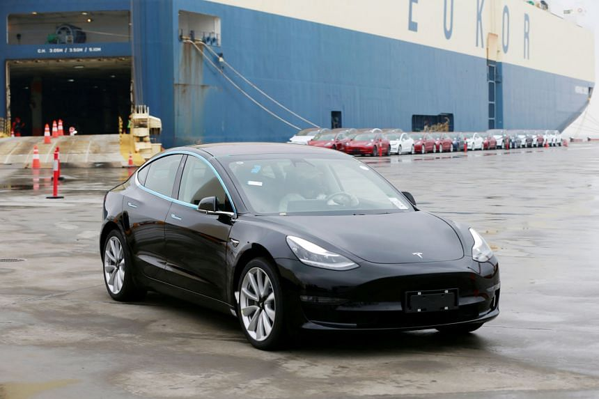 A Tesla Model 3 car leaving a cargo vessel at a port in Shanghai yesterday. The California-based firm has already adjusted prices and added a cheaper Model 3 variant to its line-up to make its US-made cars more affordable in China amid high import ta