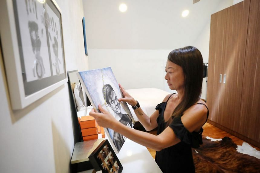 Ms Elaine Lek, whose teenage son, Zen Dylan Koh, died on Oct 1 last year. She is holding a drawing of him