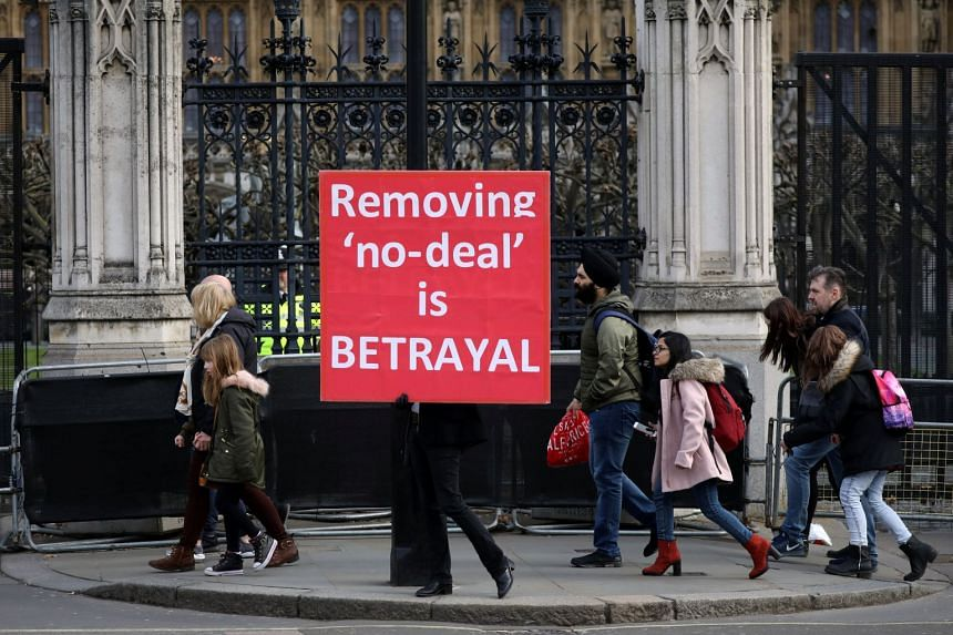 A pro-Brexit protester holds a placard outside the Houses of Parliament in London.