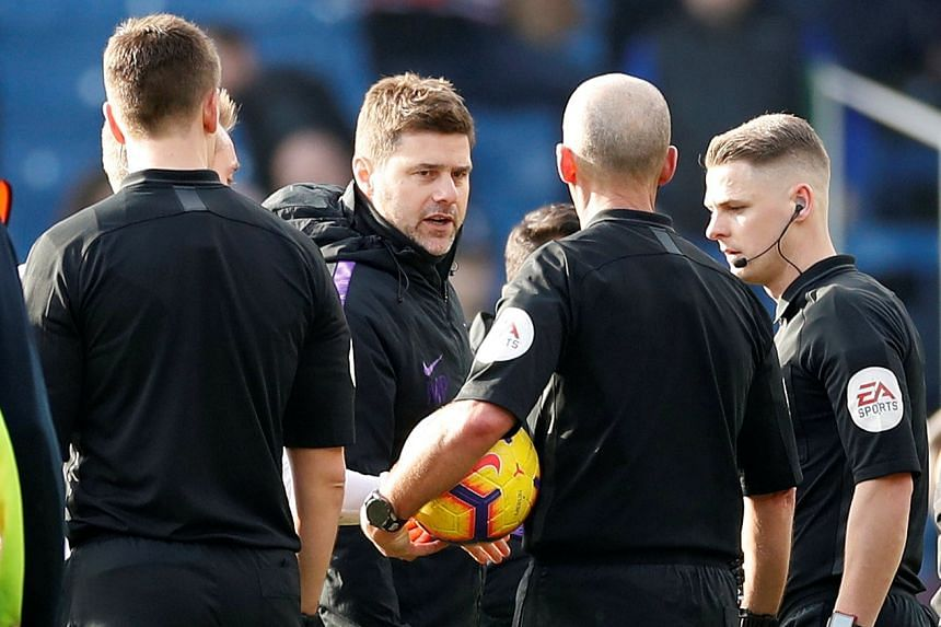 Tottenham manager Mauricio Pochettino remonstrates with referee Mike Dean after the match.