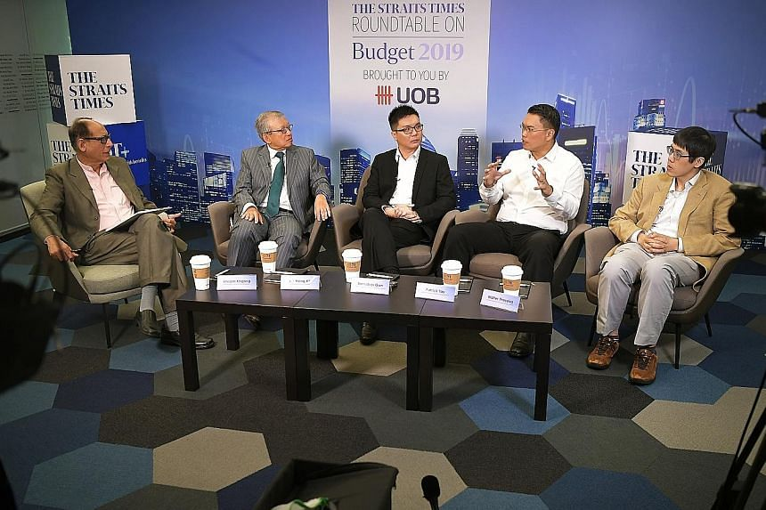 Panellists at last week's Straits Times-UOB Budget Roundtable were (from left) moderator Vikram Khanna, ST associate editor; Mr Ho Meng Kit, CEO of Singapore Business Federation; Mr Barnabas Gan, economist, UOB; Mr Patrick Tay, labour MP and NTUC ass
