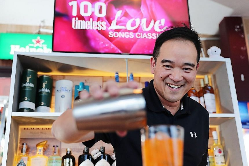 Mr Sam Weng Cham reliving a bartending moment at Happy Hut in Kallang Avenue for the photographer. The decision to enrol in an IT course 17 years ago changed his life, he says. Five years ago, he became a technopreneur and co-founded Transcend Soluti