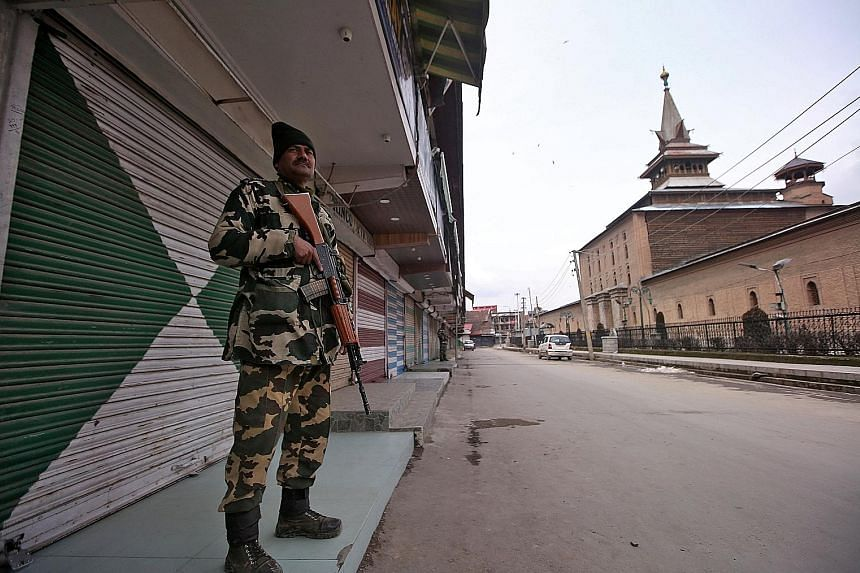 An officer from the Indian Central Reserve Police Force on guard in Srinagar, Kashmir, yesterday. India and Pakistan both claim Kashmir in entirety but control different parts of the state. The two nuclear-armed countries have gone to war thrice over
