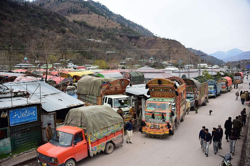 Goods trucks at the border town of Chakothi in Pakistan-administered Kashmir.