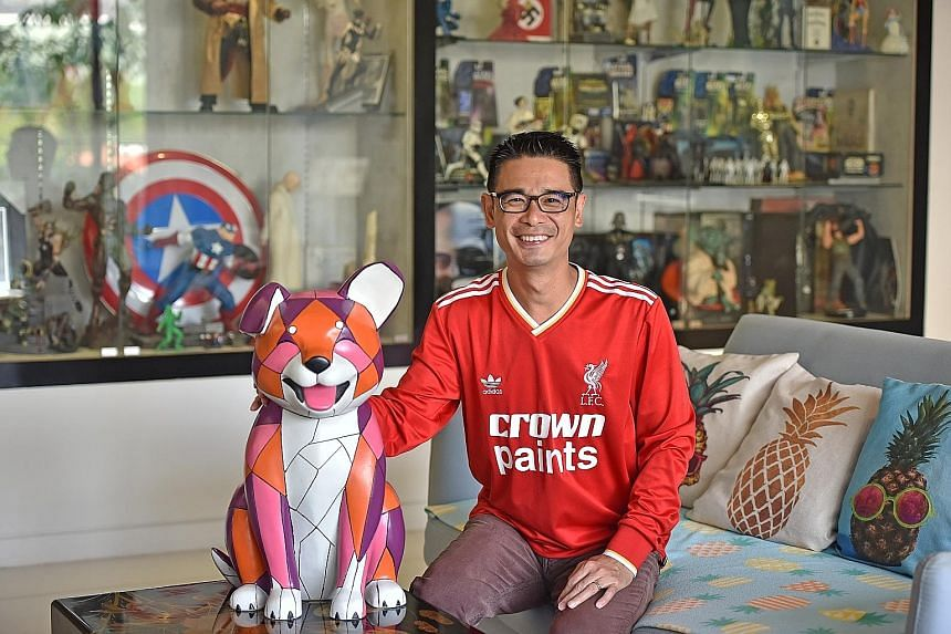 Mr Tan in his living room, his favourite part of the apartment, where he spends lots of time with his wife and daughter chit-chatting, playing board games or watching TV. It is where he also has a huge collection of rare figurines, toys and collectib