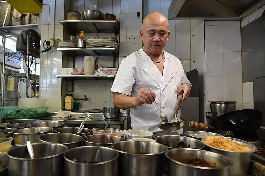 Mr Zhu Shenggang, 45, left Shandong in China to come to work in Singapore 12 years ago so he could earn more money for his children's education. The S Pass holder, who is now a head chef at halal eatery Mak's Place - The Hawkerant, works six days a w
