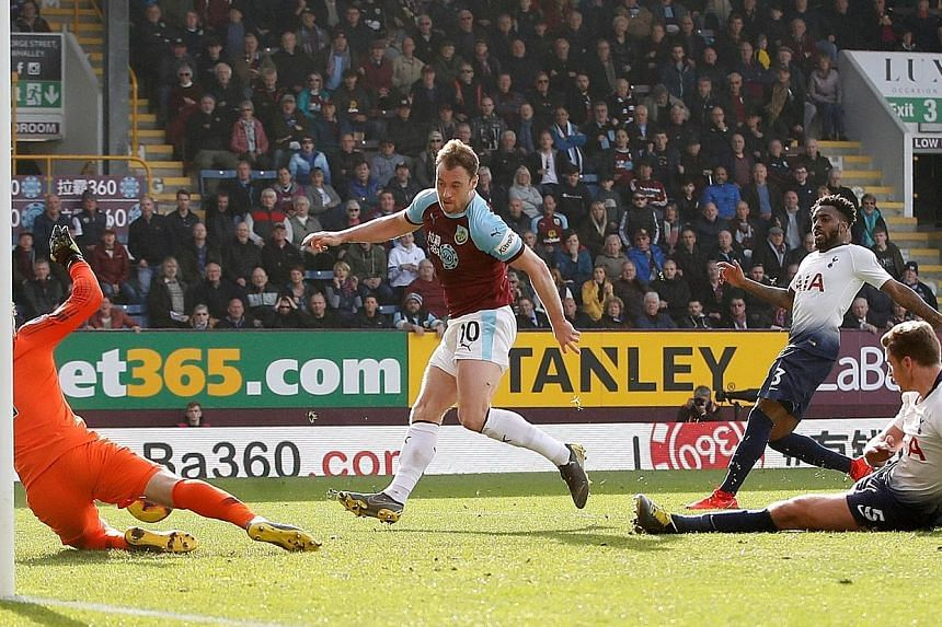Burnley's Ashley Barnes (centre) tapping the ball into the net for their second goal in the 83rd minute to beat Tottenham 2-1. It was a huge blow to Spurs' Premier League title challenge with just 11 games to go.