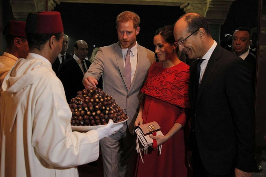 The royal couple, Harry in a light grey suit and Meghan in a red dress, were welcomed with a tray of dates, a traditional ritual of hospitality in Morocco, after they landed in Casablanca.