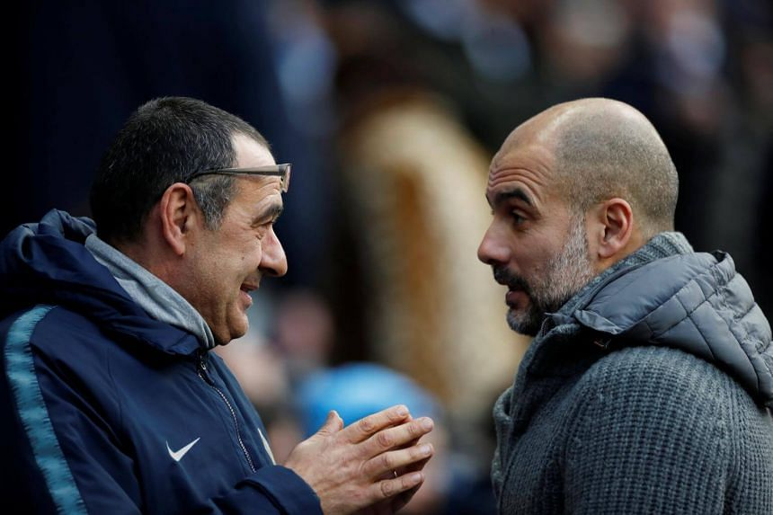 Manchester City's manager Pep Guardiola and Chelsea's head coach Maurizio Sarri ahead of the English Premier League football match between Manchester City and Chelsea at the Etihad Stadium, on Feb 11, 2019.