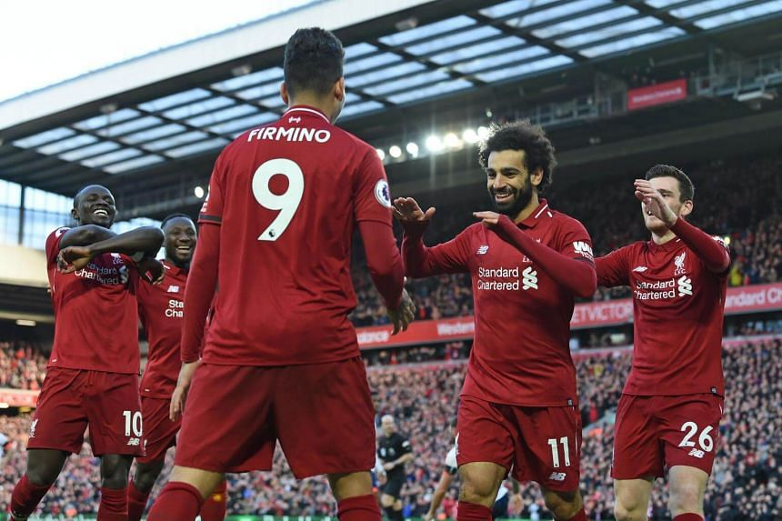Liverpool players celebrating after scoring their third goal during the English Premier League football match between Liverpool and Bournemouth at Anfield, on Feb 9, 2019.
