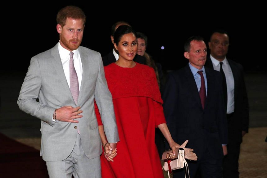 Britain's Prince Harry and his wife Meghan, as they are welcomed by British Ambassador to Morocco Thomas Reilly (second, right) upon arrival at the Casablanca Airport, in Morocco, on Feb 23, 2019.