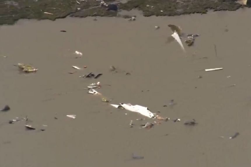 A screenshot of the scene from an online news report shows debris in the bay.