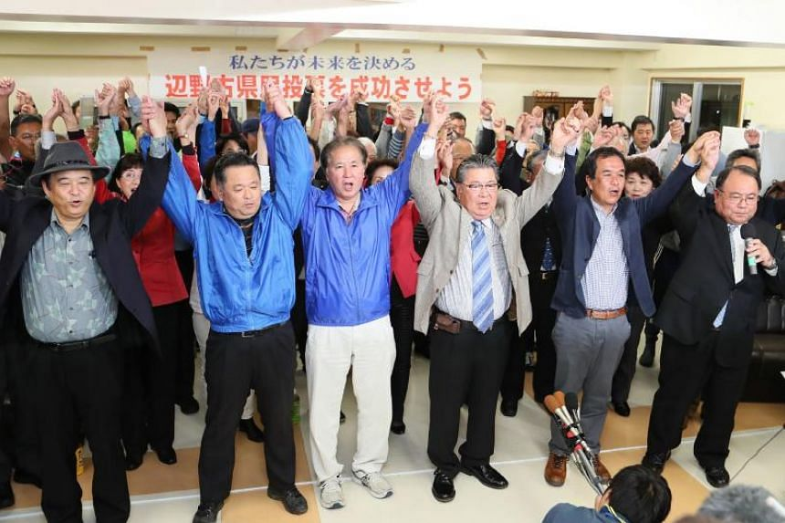 The people of Okinawa react following the results of a referendum on the relocation of a US military base in Naha, Okinawa Prefecture, on Feb 24, 2019.