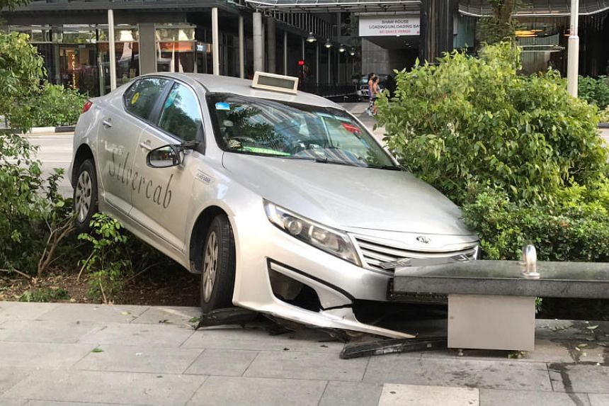 The taxi was seen on a pavement along Orchard Road after an accident on Feb 24, 2019.