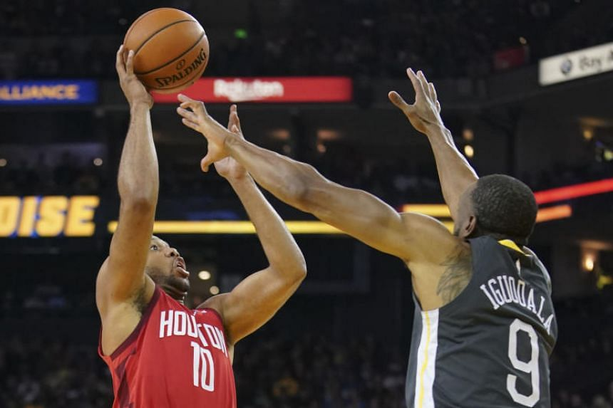 Houston Rockets guard Eric Gordon shoots against Golden State Warriors guard Andre Iguodala during their NBA game at Oracle Arena in Oakland, California, on Feb 23, 2019.