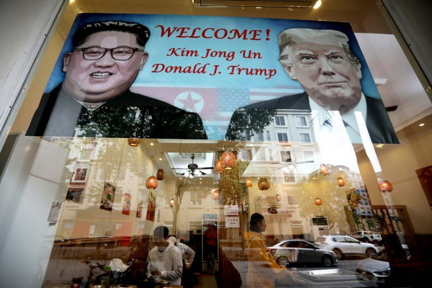 A poster featuring the upcoming second summit between the US and North Korea is seen at a restaurant in Hanoi, Vietnam, on Feb 23, 2019.