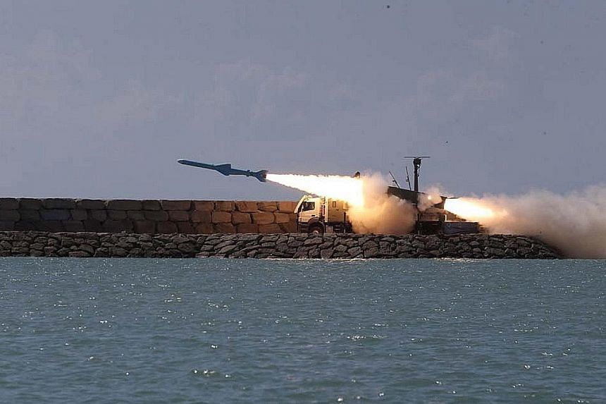 The ground-to-ship short-range cruise missile Ghader is seen in an Iranian Navy Office photo being test-fired in the Sea of Oman on Saturday.
