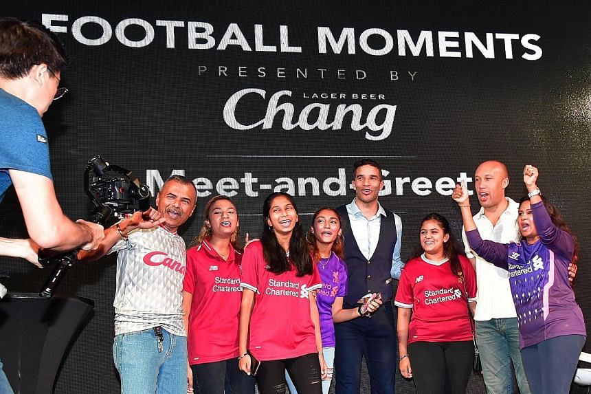 From left: Liverpool fans James Linus, Isabelle Linus, Gabrielle Joseph, Anabelle Linus, former Liverpool goalkeeper David James, Udabelle Linus, ex-Manchester United defender Mikael Silvestre and Vanessa Tifanny pose for a group shot. They were amon