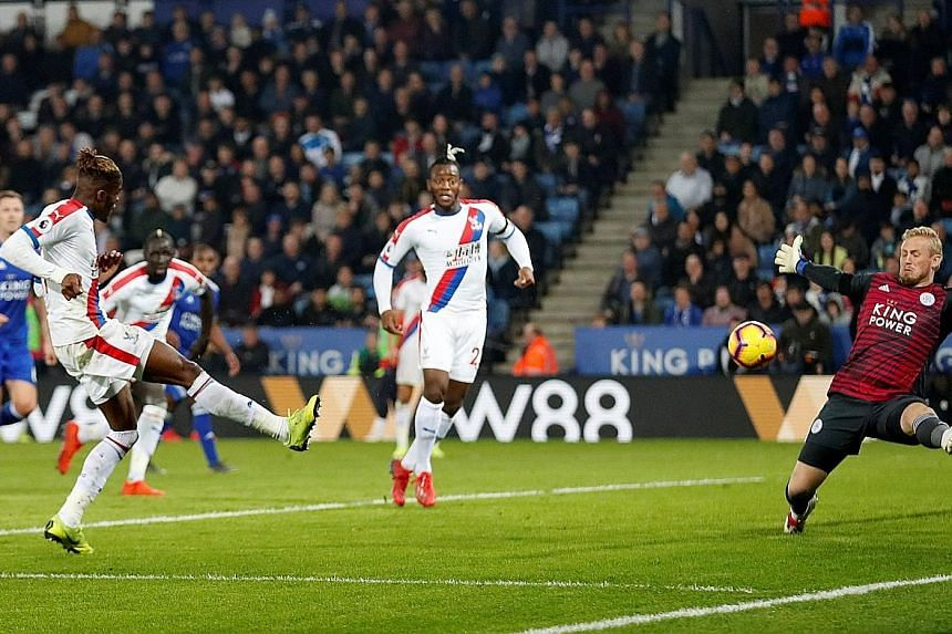Wilfried Zaha scoring the second goal for Crystal Palace who beat Leicester 4-1 on Saturday. The Foxes dismissed manager Claude Puel after the club's fourth straight home loss.