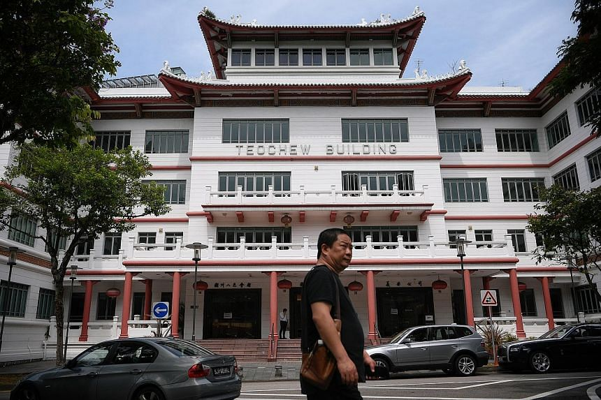 The Teochew Building in Tank Road, off River Valley Road, has housed both the Teochew Poit Ip Huay Kuan and Ngee Ann Kongsi since it was built in 1963. From left: Honorary secretary for Teochew Poit Ip Huay Kuan Woo Chee Chay, president Chua Kee Tean