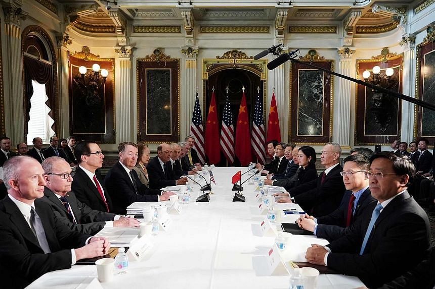 US and Chinese officials at trade talks in Washington on Thursday. The talks have been extended by two days as both sides race to reach a deal before higher US tariffs for Chinese goods kick in on March 1.