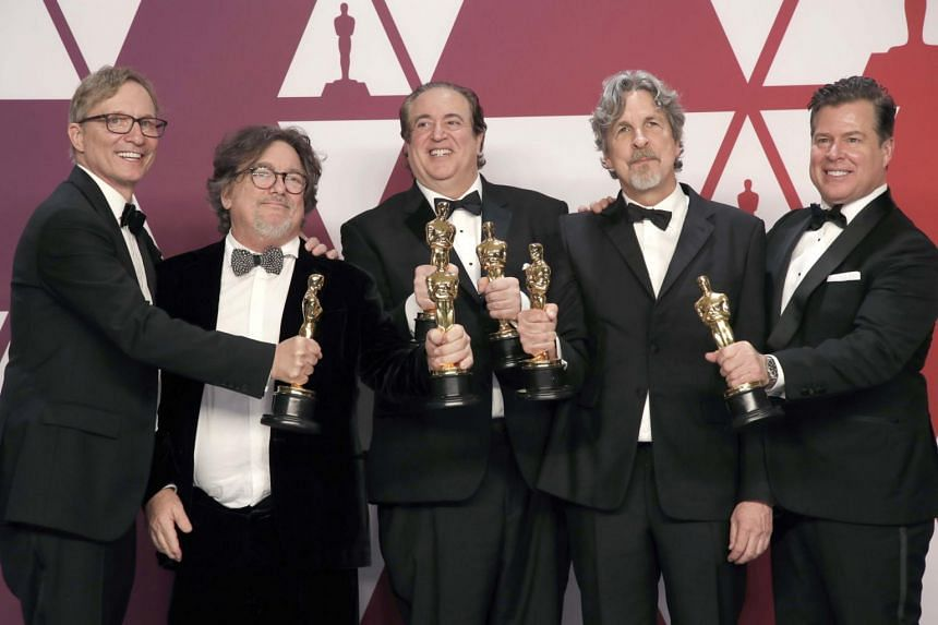 (From left) Green Book producers Jim Burke, Charles Wessler, Nick Vallelonga, Peter Farrelly and Brian Hayes Currie pose with their Best Picture awards.